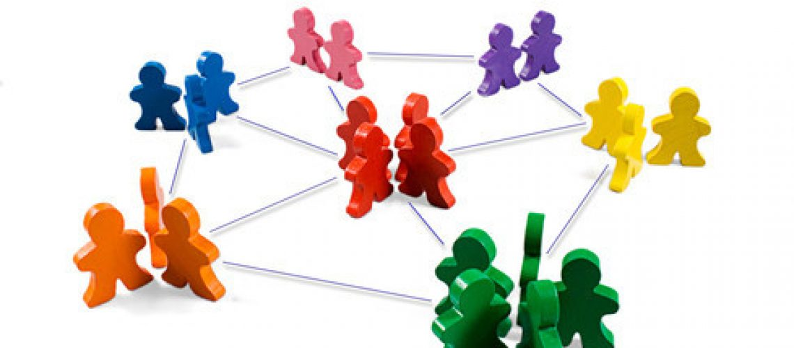 Business concepts illustrated with colorful wooden people - networking, organizational groups, or workgroups.